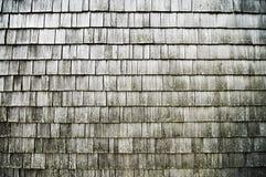Gamla trägråa notsystem på en vägg gillar en bakgrund Arkivbild