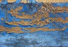 Gamla trämålade blått och gul lantlig bakgrund arkivfoto