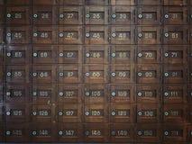 Gamla träpostboxar Arkivfoto