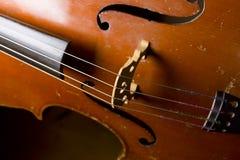 Gamla violoncellrader arkivfoto