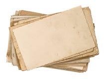 Gamla vykort som isoleras på vit Åldrigt pappers- texturerar Royaltyfri Bild