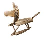 Gamla wood leksaker som vaggar hästen, presiderar barn som är roliga på vit Arkivfoto