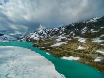 Gamle Strynefjellsvegen. Frozen lake by Gamle Strynefjellsvegen national tourist road in Norway Stock Photos
