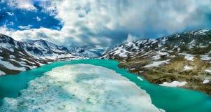 Gamle Strynefjellsvegen. Frozen lake in norwegian mountains on Gamle Strynefjellsvegen mountain pass, aerial panorama Royalty Free Stock Images