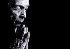 ηλικιωμένη προσευμένος &gamma Στοκ Εικόνες