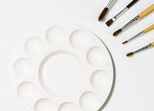 Gamma di colori di arte con le spazzole Fotografia Stock