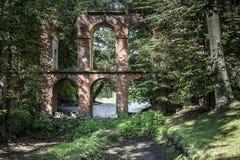 Gammal akvedukt som byggs av tegelsten i Arkadia Royaltyfri Fotografi