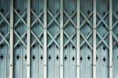 Gammal Aluminium hopfällbar dörr Fotografering för Bildbyråer