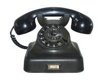 Gammal antik telefon som isoleras royaltyfria bilder