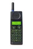 Gammal använd mobiltelefon, vit bakgrund arkivbild