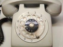 Gammal använd telefon med den roterande visartavlan Royaltyfri Fotografi
