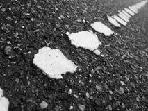 Gammal asfaltväg Arkivfoto