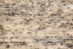 Gammal bakgrund för abstrakt begrepp för vägg för tegelstenbiegesvart, modell Arkivfoton