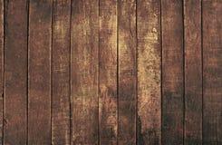 Gammal bakgrund för plankor för mörk brunt för tappning trä Arkivfoto