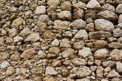 Gammal bakgrund för stenvägg, Cembolo fästning Arkivfoto