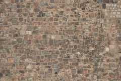 Gammal bakgrund för stenvägg - naturlig stenvägg arkivfoton