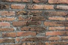 Gammal bakgrund för textur för vägg för röd tegelsten för agg arkivbilder