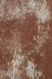 Gammal betongvägg med skadad målarfärg din bakgrundsdesign Arkivbilder