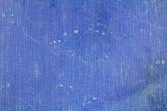 Gammal blå textiltextur med att blekna och fläckar abstrakt bakgrund Arkivfoto