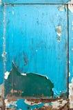 Gammal blå wood dörr riden ut textur Royaltyfri Bild