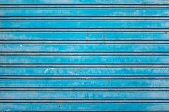 Gammal blått stänger med fönsterluckor Royaltyfri Fotografi