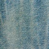 Gammal blåttkanfas texturerar bakgrund för grungebakgrundsdenim Arkivfoton