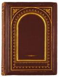 Gammal bok med den förgyllda prydnaden royaltyfri foto