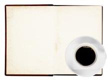 Gammal bok med kaffe Arkivbild