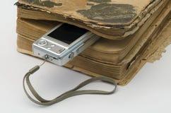 Gammal bok och en digital kamera royaltyfri fotografi