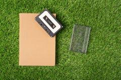 Gammal bok på grönt gräs Fotografering för Bildbyråer