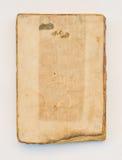Gammal bok på vit bakgrund Arkivbilder