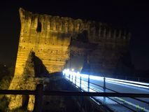 Gammal bro med ljusa spår Royaltyfria Bilder