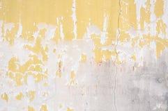 Gammal cementvägg, konstruktion för forntida buse för sten för designtexturbakgrund stark, gulingbetongmodell Royaltyfria Foton