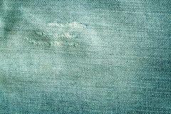 Gammal cyan färgjeanstextur med skrapor Royaltyfri Fotografi