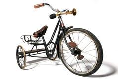 Gammal cykel i retro stil arkivbilder