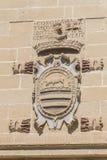 Gammal detalj för rättvisahus- och arrestfasad, nu stadshus, Baeza, royaltyfri bild