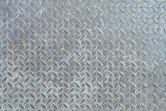 Gammal Diamond Metal Plate Background, rengöringsduktempel och urklippsbokdanande arkivfoton