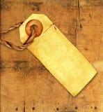 gammal etikett ridit ut trä arkivbilder