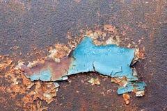 Gammal exfoliated målarfärg och textur av rostig metall arkivfoton