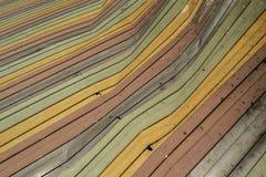 Gammal färgrik skadad bakgrund för tak för metallark Arkivfoto