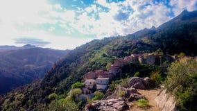 Gammal by för berg Arkivbild