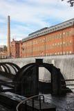 Gammal fabrik för röd tegelsten. Industriellt landskap. Norrkoping. Sverige Royaltyfria Bilder