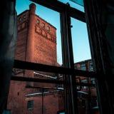 Gammal fabrik, som ser som slott Royaltyfri Foto