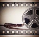 Gammal filmfilmrulle med filmremsan royaltyfri foto