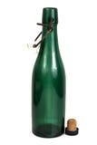 Gammal flaska av grönt exponeringsglas Royaltyfri Foto