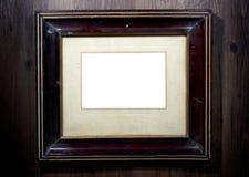 Gammal fotoram på väggen royaltyfri fotografi