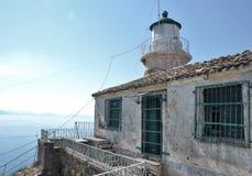 Gammal fyr på Korfu Grekland fotografering för bildbyråer