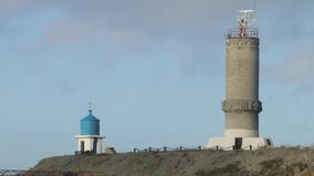 Gammal fyr på station Havstorn och Watchtower Gammal marin- station arkivfilmer
