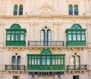 Gammal Gio Batta Delia fasadbyggnad i Valletta arkivbild