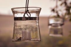 Gammal glass lykta med den vita stearinljuset Royaltyfri Bild